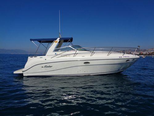 Imbarcazione a motore Rinker Fiesta Vee 310 (2002)